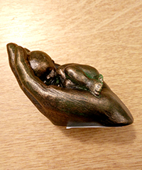 Baby in Hand Small Resin (bronze colour)